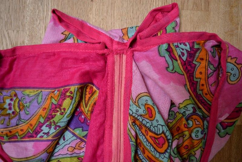pleats and zip closure