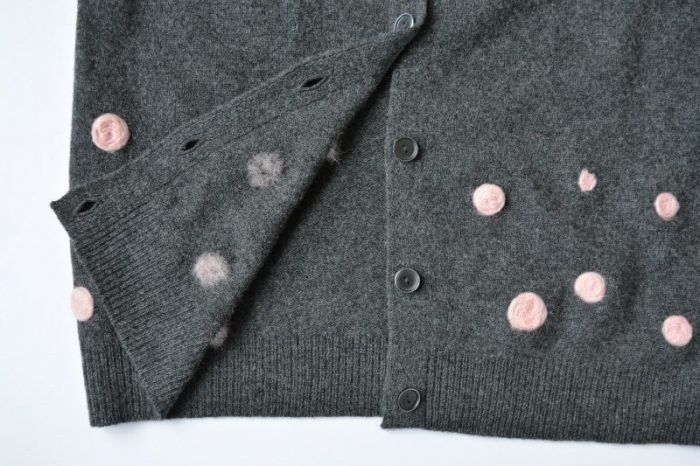 Repair a moth holed jumper using needle felt, create a stylish new look to a former sweater. Quick and easy modernisation