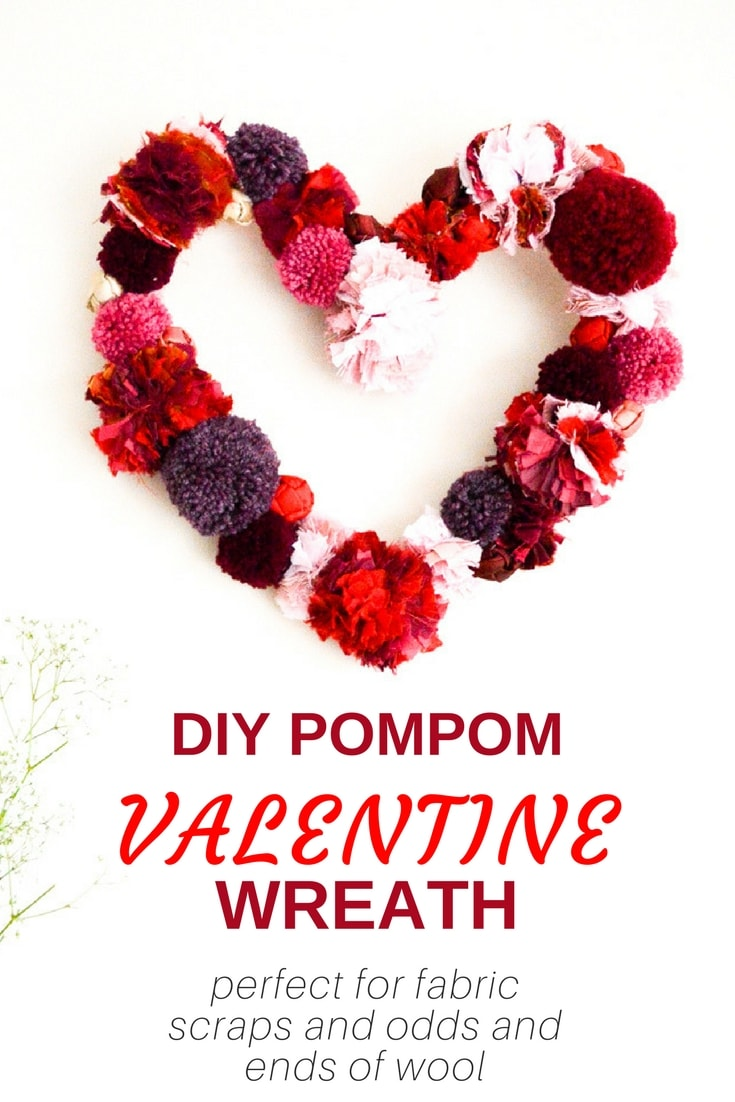Easy DIY decor for Valentine's. Learn how to make this goregous tactile pompom valentine wreath, the perfect project for odds and ends of yarn. Click through to the valentine wreath tutorial to see how to make the heart base, a great decoration for your home.