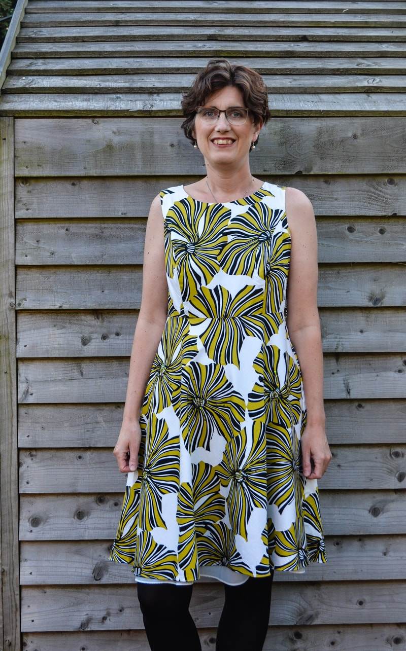 DIY Dress refashion into a kamino top. Learn how to create your pattern and transform your dress into a stylish top - a fun refashion.