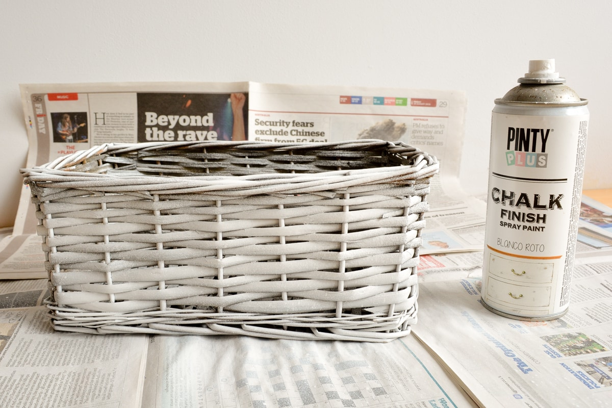 basket with one coats of spray chalk paint