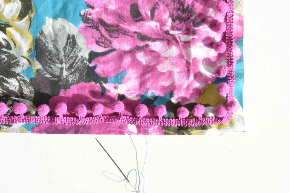Easy DIY envelope cushion with pom-pom trim 10