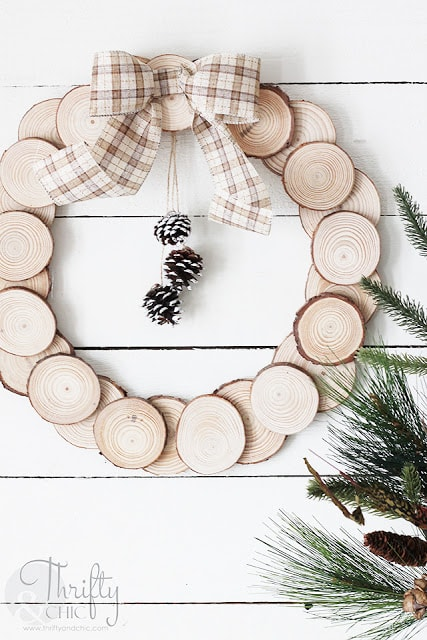 Easy wreath idea using wood slices, ribbon and pinecones