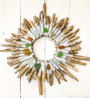 It is super easy to make a stunning driftwood wreath, learn how to make your own driftwood wreath with this detailed photo and video tutorial, bring a touch of the beach into your home.