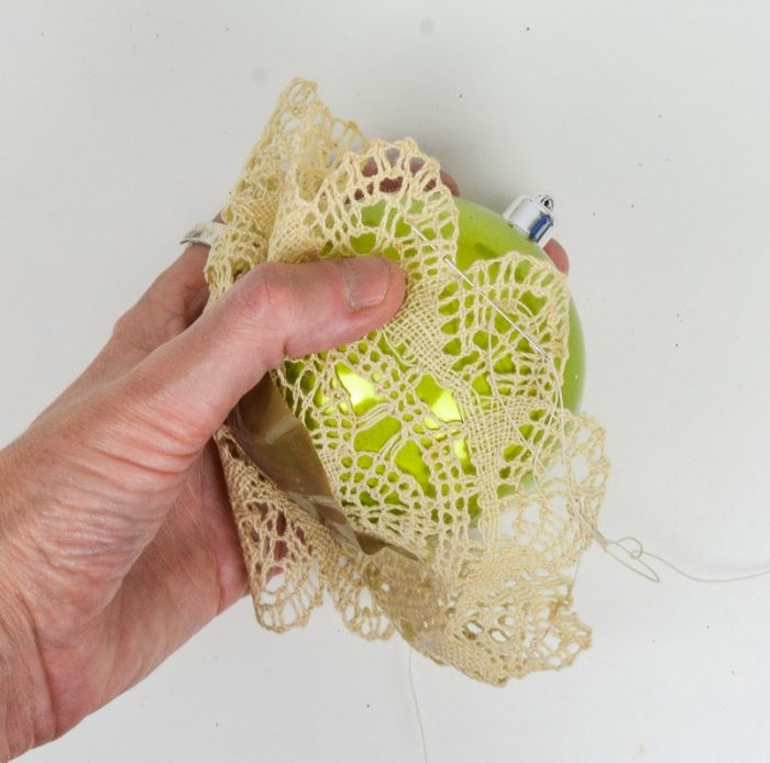 Transform your damily heirloom vintage doilies into upcycled Christmas decorations - super quick and easy to make add a vintage feel to baubles.
